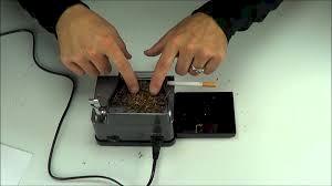 Powerautomatic cigarette rolling machines